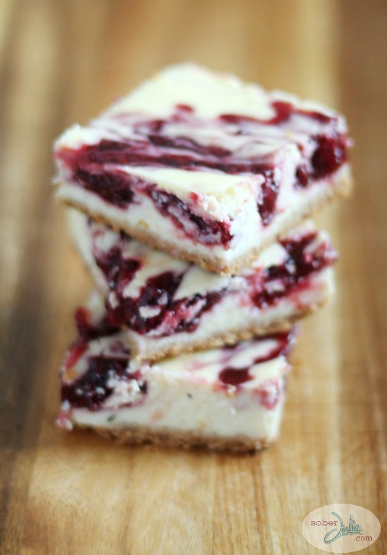 raspberry swirl cheesecake bars stacked