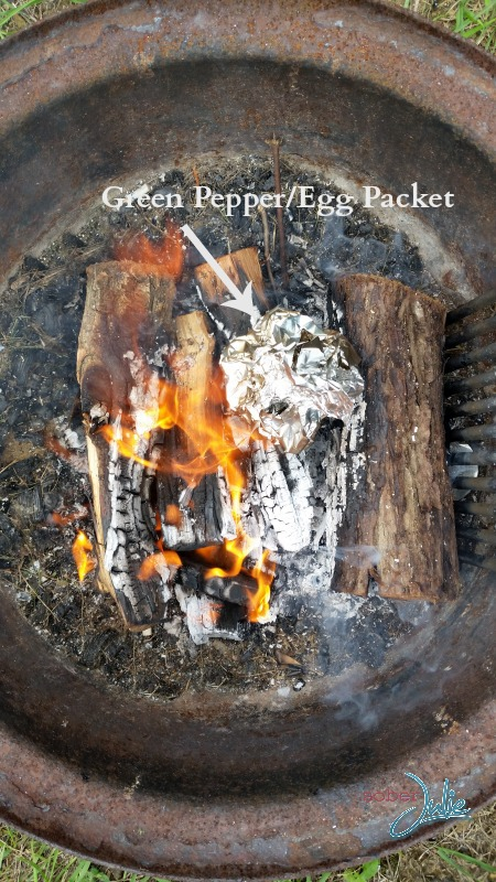 Eggs in Green Peppers on the Campfire in flames