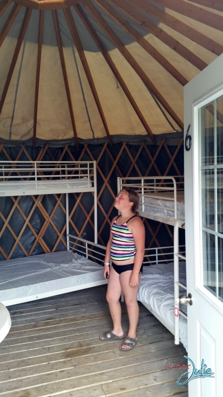 family camping inside yurt