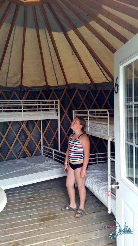 family camping inside yurt